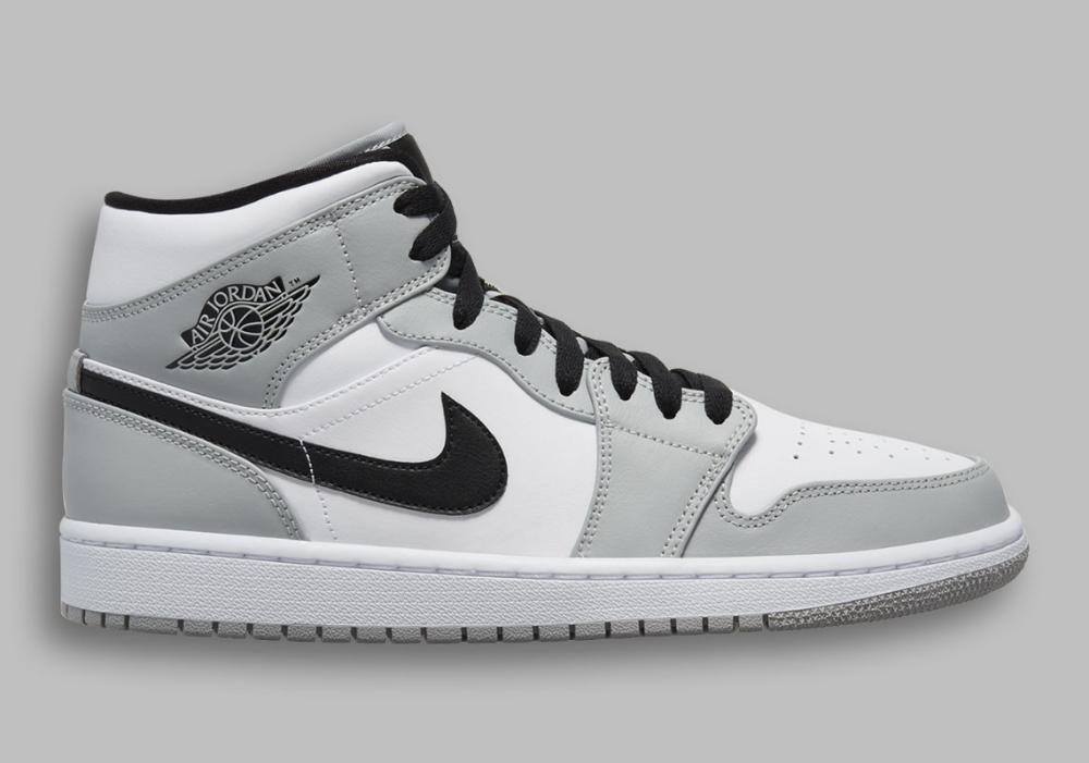 gray and white retro jordans