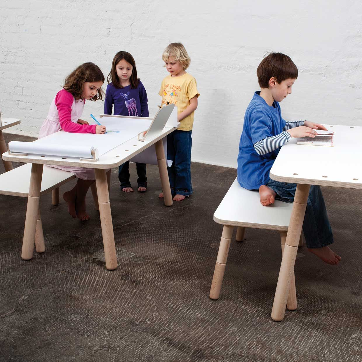 Height Adjustable Solid Wood Kids Desk Shown At Its Lowest Height