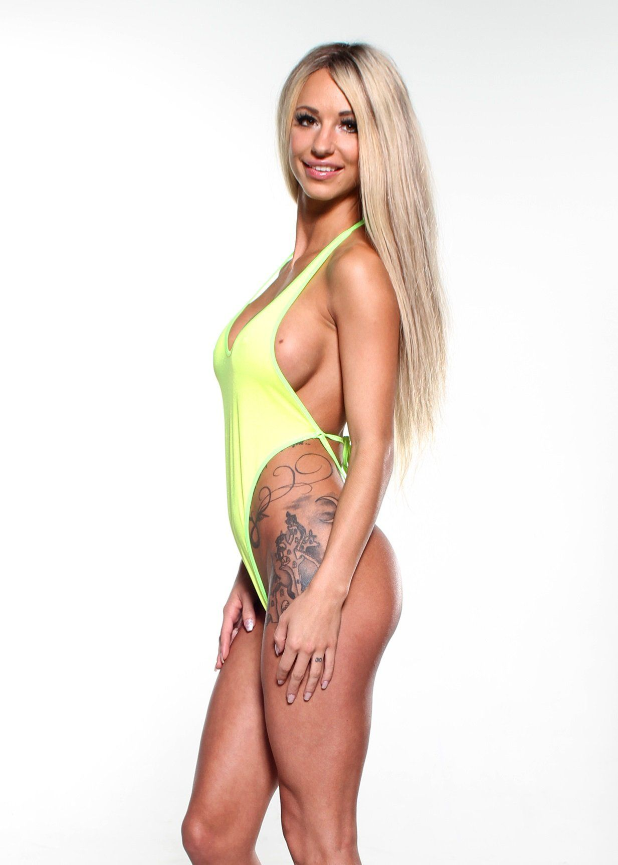 340aa727ecc4e Solid Yellow Sexy Monokini One Piece Micro String Thong Bikini DARE w Neon  Green at Amazon Women's Clothing store: