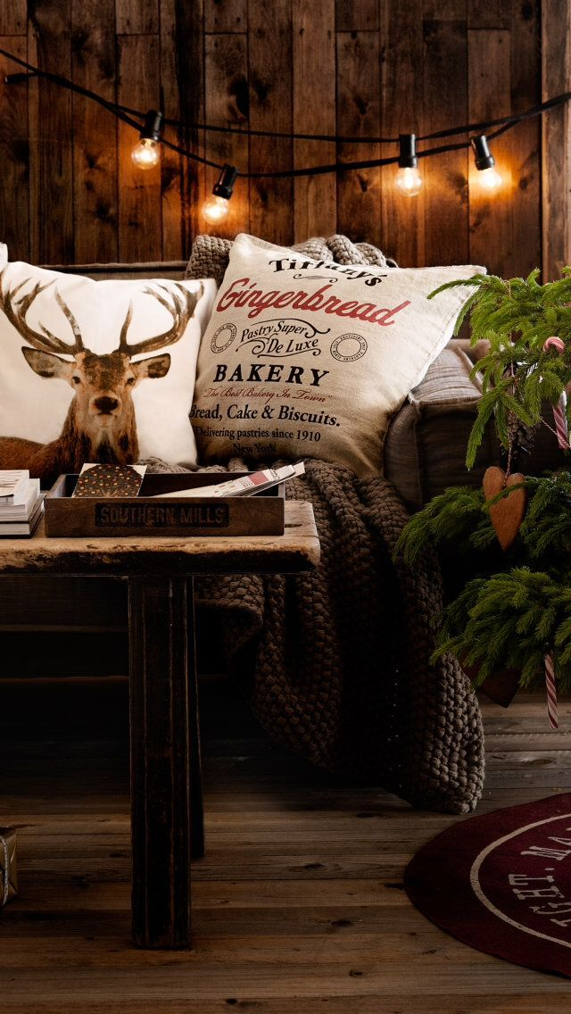 reindeer inspired pillows with rustic christmas decor i love the lights against the - Cabin Christmas Decor