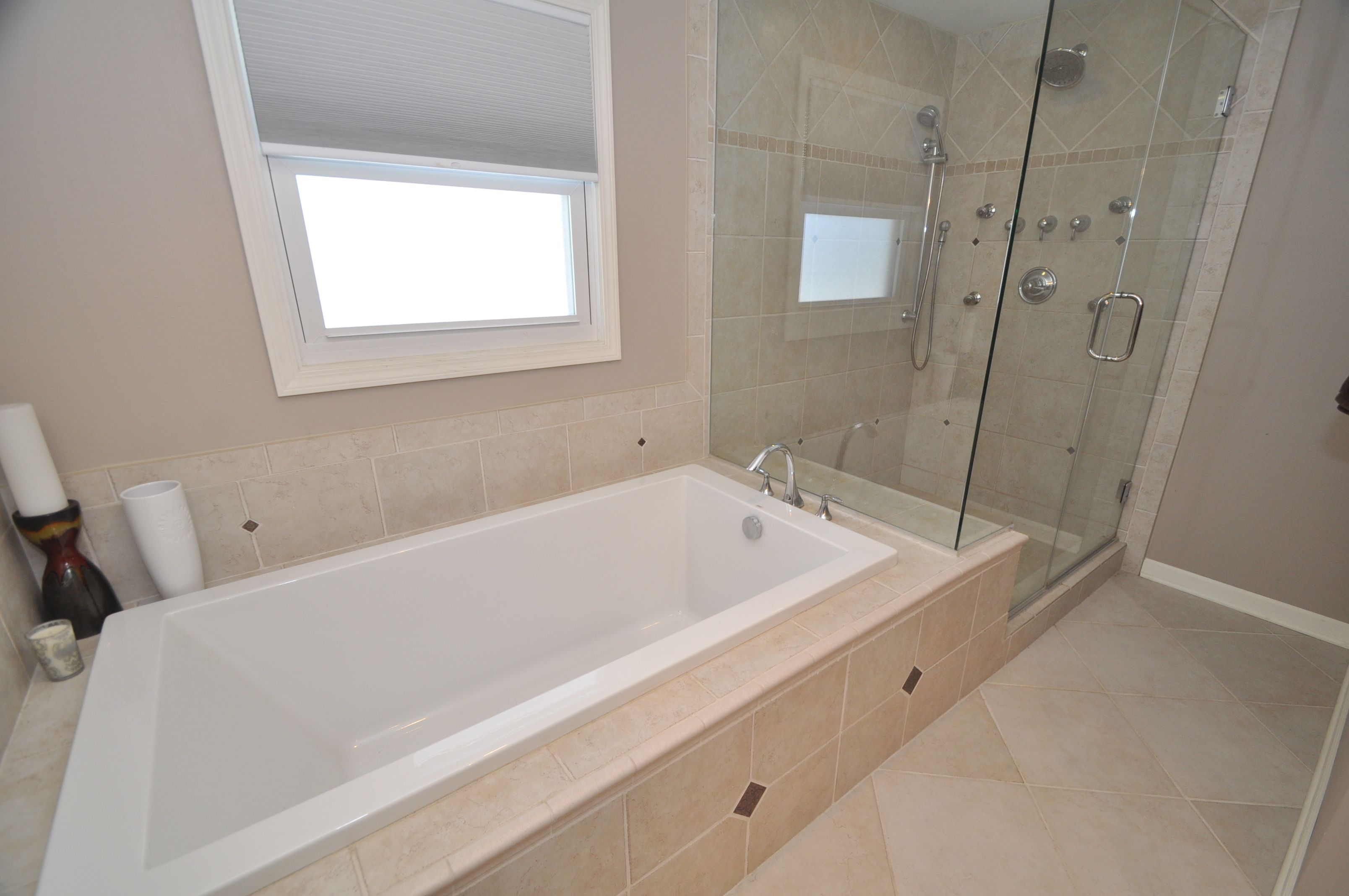 deep soaker tub and body sprays along with a handheld shower system ...