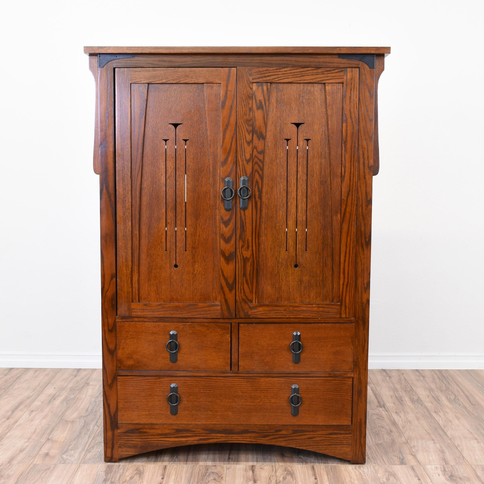 This craftsman style armoire is featured in a solid wood ...