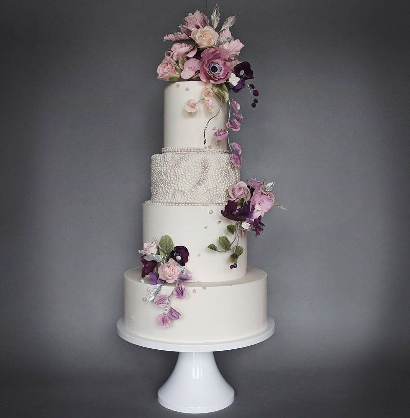 22 Beautiful wedding cakes to inspire you : Four tier wedding cake topped with sugar floral