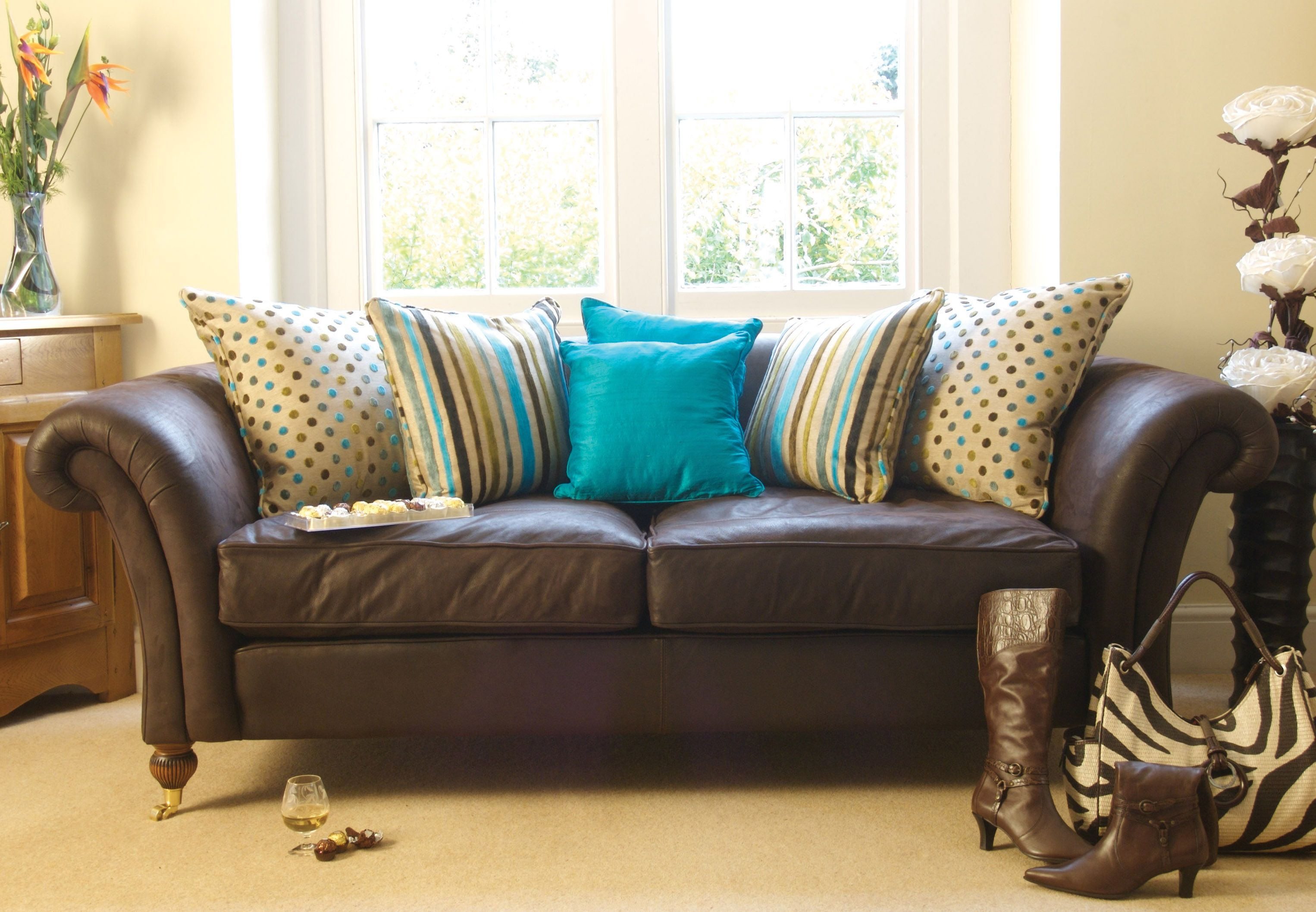 turquoise on brown sofa  for my home  pinterest  brown