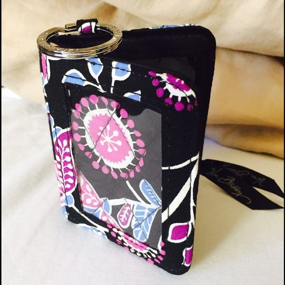 Vera Bradley ID/change purse NWOT 4x3in NWOT VeraBradley ID/change purse,new & never used but no tags,  BUY EITHER MAILBAG OR THE MIDNIGHT PAISLEY TOTE AND GET THIS FREE!! Vera Bradley Accessories Key & Card Holders