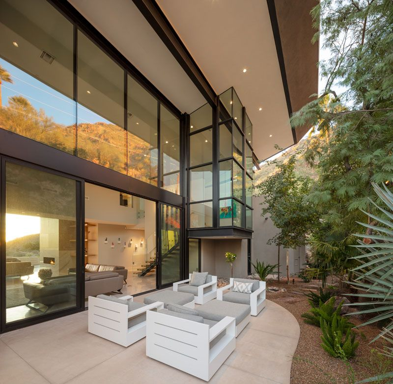 This modern house has  small patio that   located against the hillside and is furnished also cholla vista home by kendle design collaborative outdoor spaces at rh pinterest