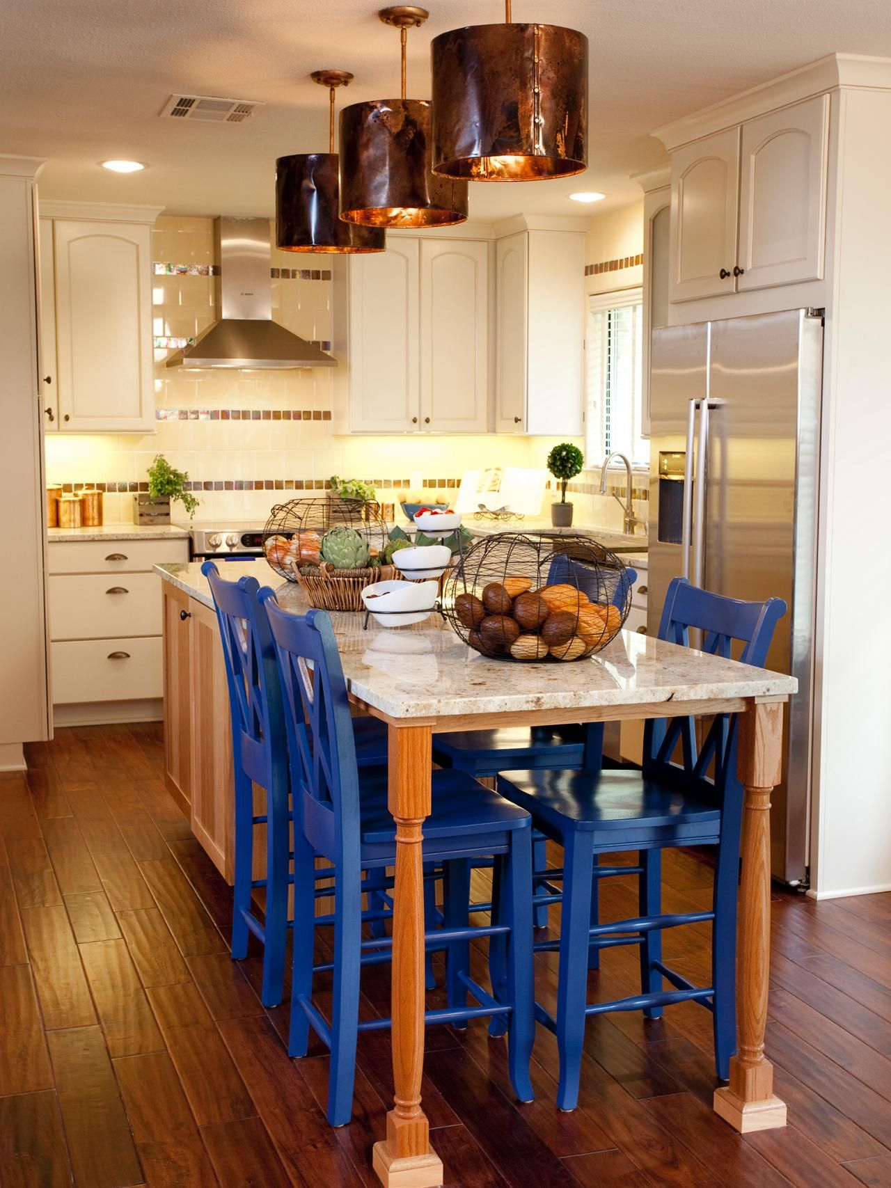White Kitchen With Spacious Island And Blue Chairs Chairs For Kitchen Island Small Kitchen Tables Kitchen Island Table