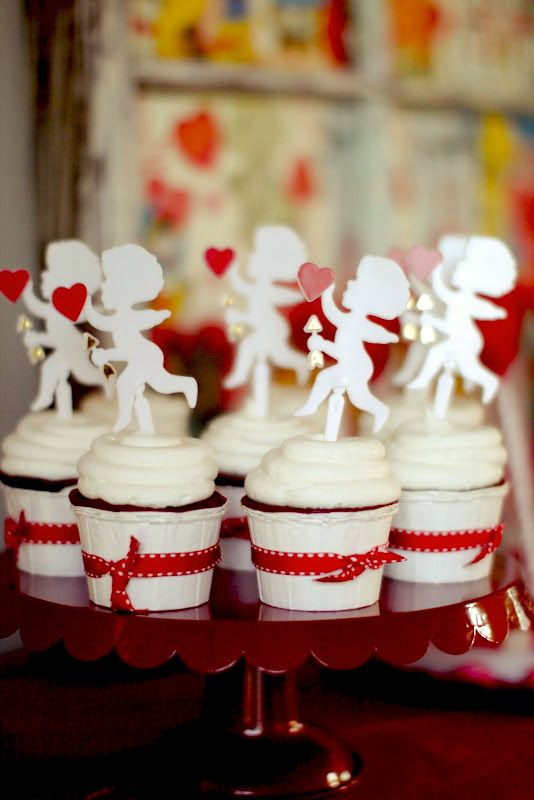 Love the cupid cupcake toppers
