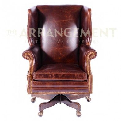 Hair On Hide Office Chair Turquoise Accent Big Hoss Wingback Desk Wraps Around This Handsome Swivel Casters Dark Distressed Leather Stretches Over The Seat Back