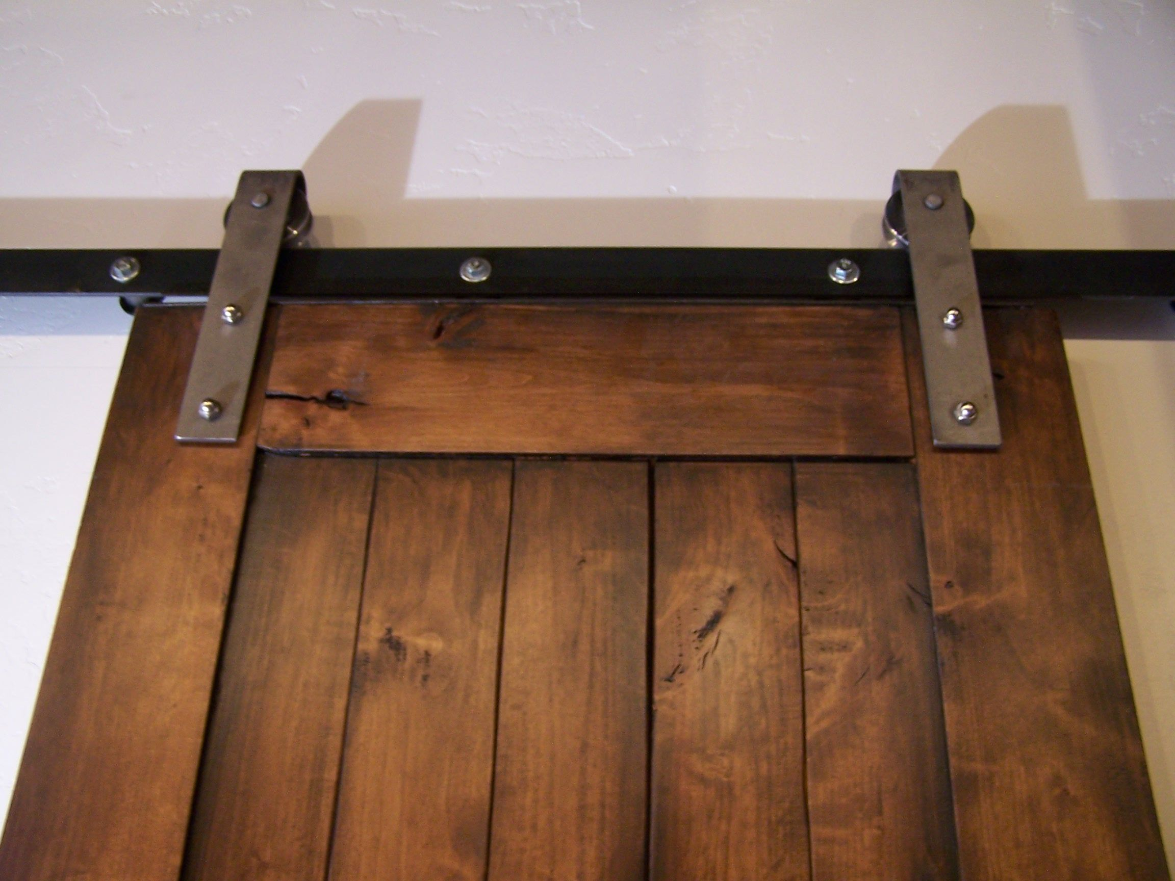 Industrial Barn Door Hardware With A Brushed Steel Finish The