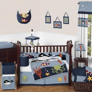 Ocean Blue 9 pc Crib Bedding set has all that your little bundle of joy will need. Let the little one in your home settle down to sleep in this incredible nursery set. This baby boy bedding set features detailed fish and sea life themed appliques and embroidery works. This collection uses the stylish colors of blue, navy, red, orange, yellow, green, black, and crisp white.