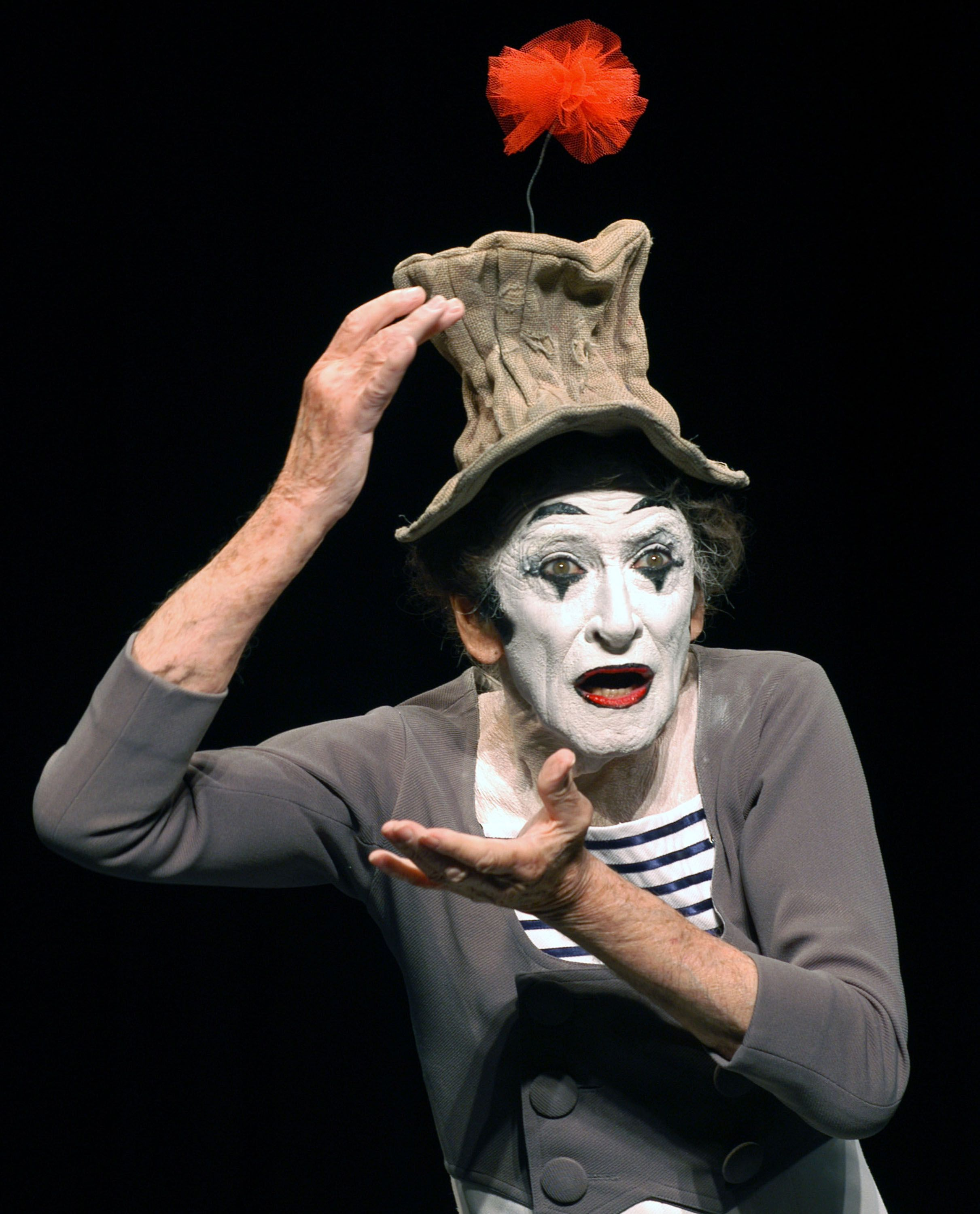 "Marcel Marceau's crumpled top hat is illustrated in ""Happy"