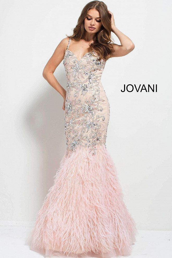 96fd6e6db026 Form fitting floor length crystal embellished blush pageant gown with  mermaid feather bottom features spaghetti strap bodice with sweetheart  neckline.