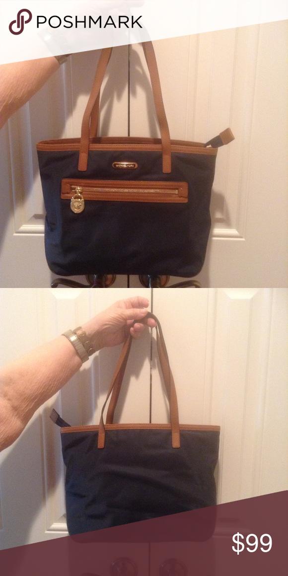 c51bc36c3d182e AUTH Michael Kors Kempton Nylon Tote Navy nylon with brown trim. Excellent  condition. Measures 14.5 x 9.5x4.5 Michael Kors Bags Shoulder Bags