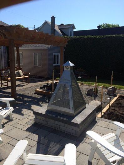 Jardin zen avec un foyer de conception brisson paysagiste for Amenagement vestibule maison