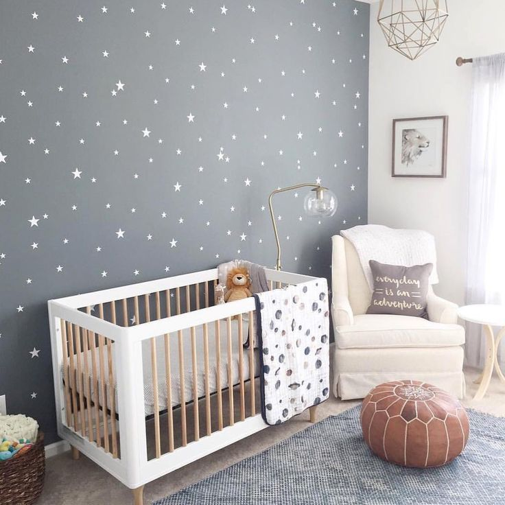 Cozy gender neutral nursery with focal wallpaper.