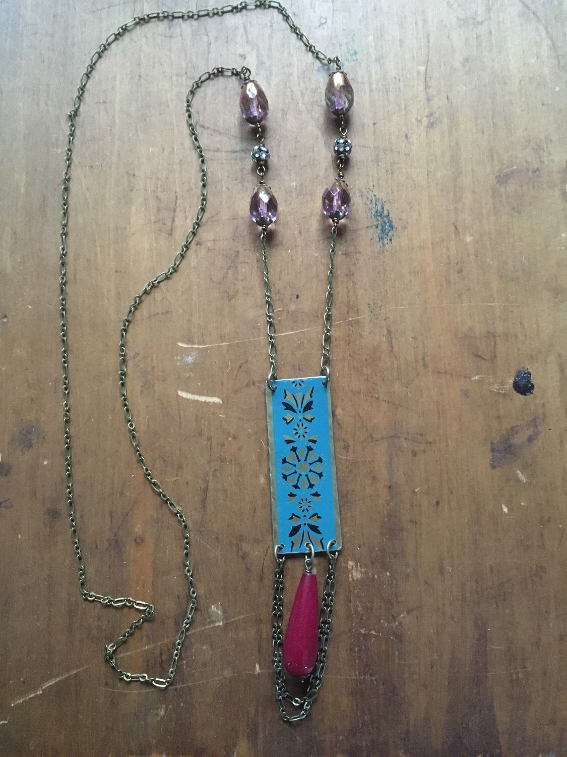 A personal favorite from my Etsy shop https://www.etsy.com/listing/507824723/teal-and-pink-vintage-tin-necklace