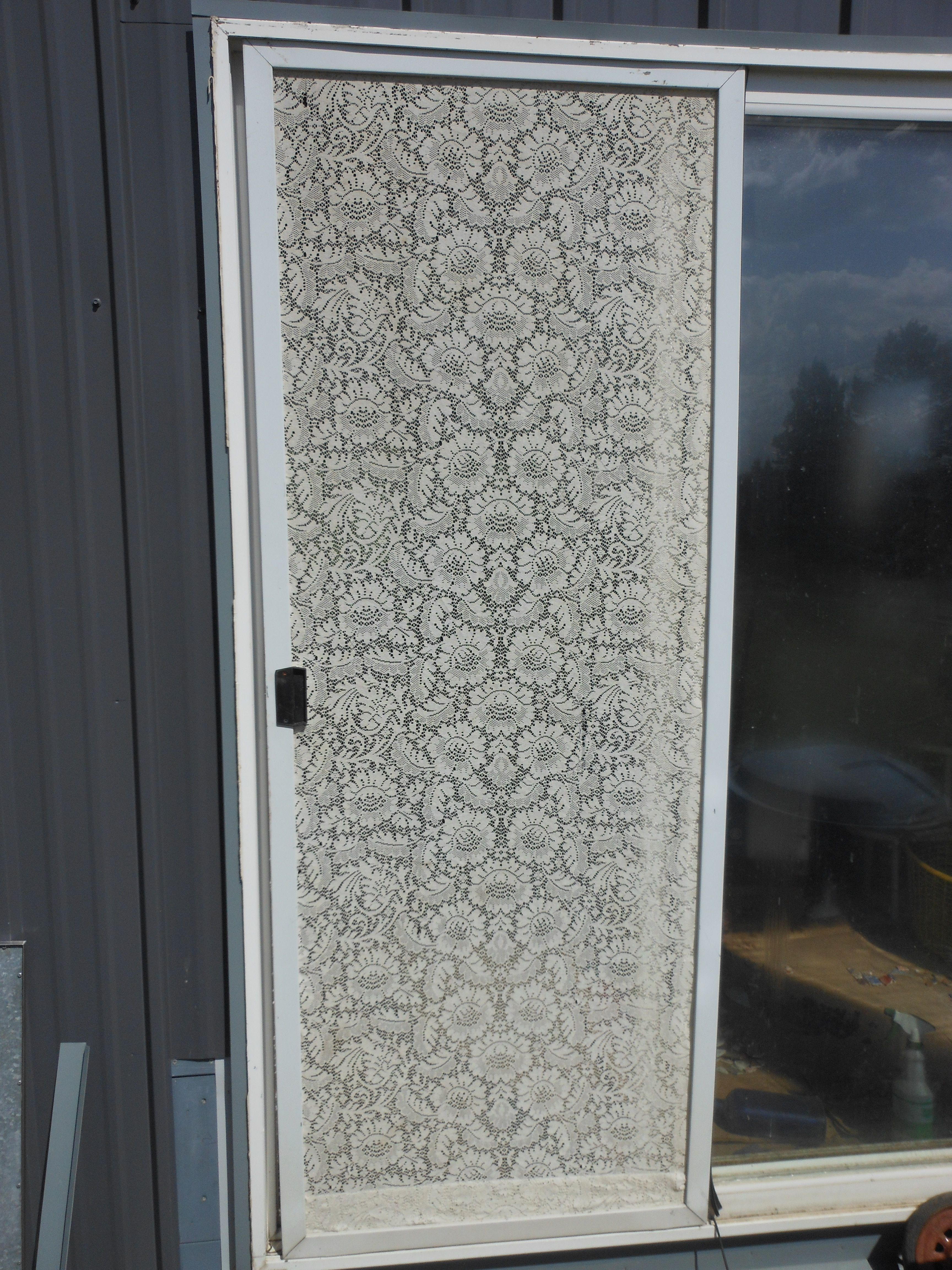 Old curtain used for screen door.