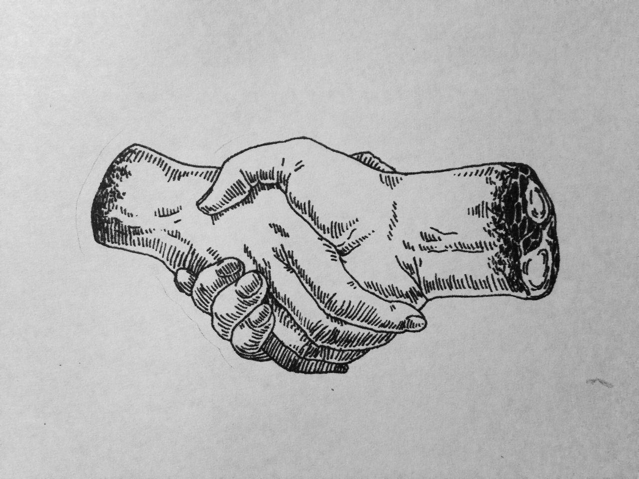 Black Hand And White Hand Shaking