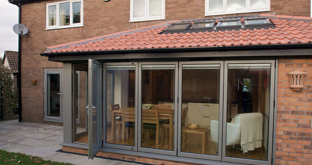 A range of external blinds giving a neat finish to bi folding doors ...