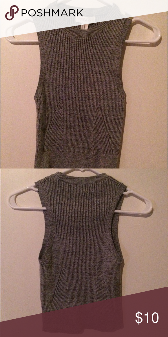 Knit Crop Tank Cute crop tank. Bought for a trip and never wore! Could pass as a regular top with higher waist pants (not super cropped). Feels like a size small. Forever 21 Tops Tank Tops