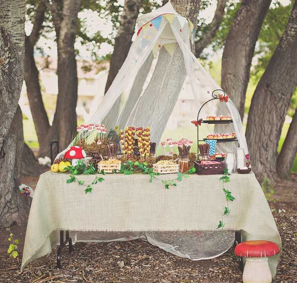 Woodland Party: IKEA canopy, toadstool cupcakes, moss mounds to hold marshmallow pops + fruit skewers