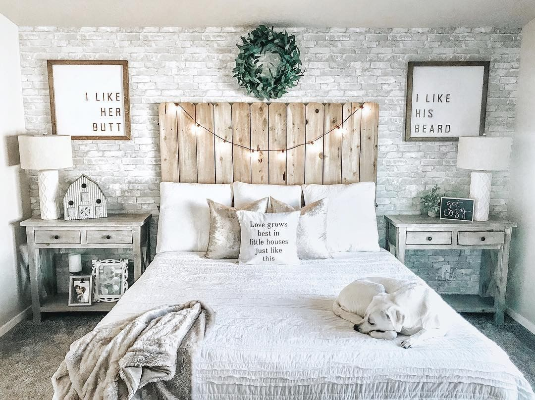 This Master Is B E D R O O M Goals With Twinkly Lights Grey Brick Accent Wall And A Wooden Headboard Brick Wall Bedroom Bedroom Headboard Rustic Bedroom