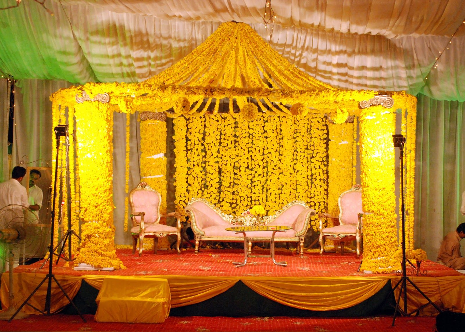 Mehndi Flower Arrangements : Beautiful yellow color mehndi stage flower arrangements get