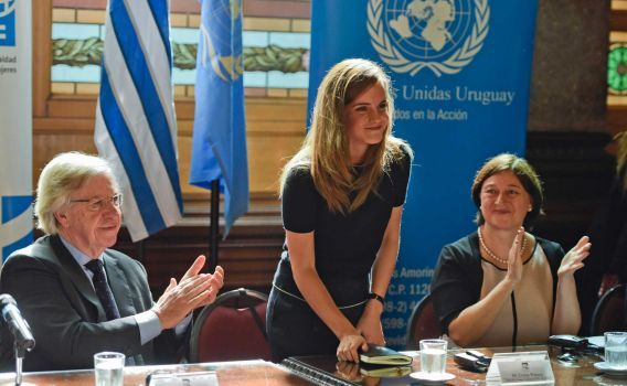 Uruguay's Vice President Danilo Astori, left, and Director of UN Women Gulden Turkoz, right, applaud after a speech by Emma Watson, UN Women Goodwill Ambassador, at Parliament in Montevideo, Uruguay, Wednesday, Sept. 17, 2014. Watson attended the event organized by women's groups pushing the country's lawmaking body to increase their numbers of elected female senators and deputies. Photo: Matilde Campodonico, AP / AP