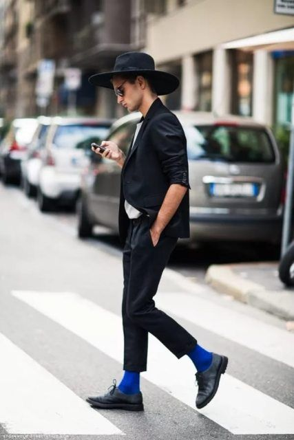 With white shirt, black blazer, blue socks, shoes and wide brim hat
