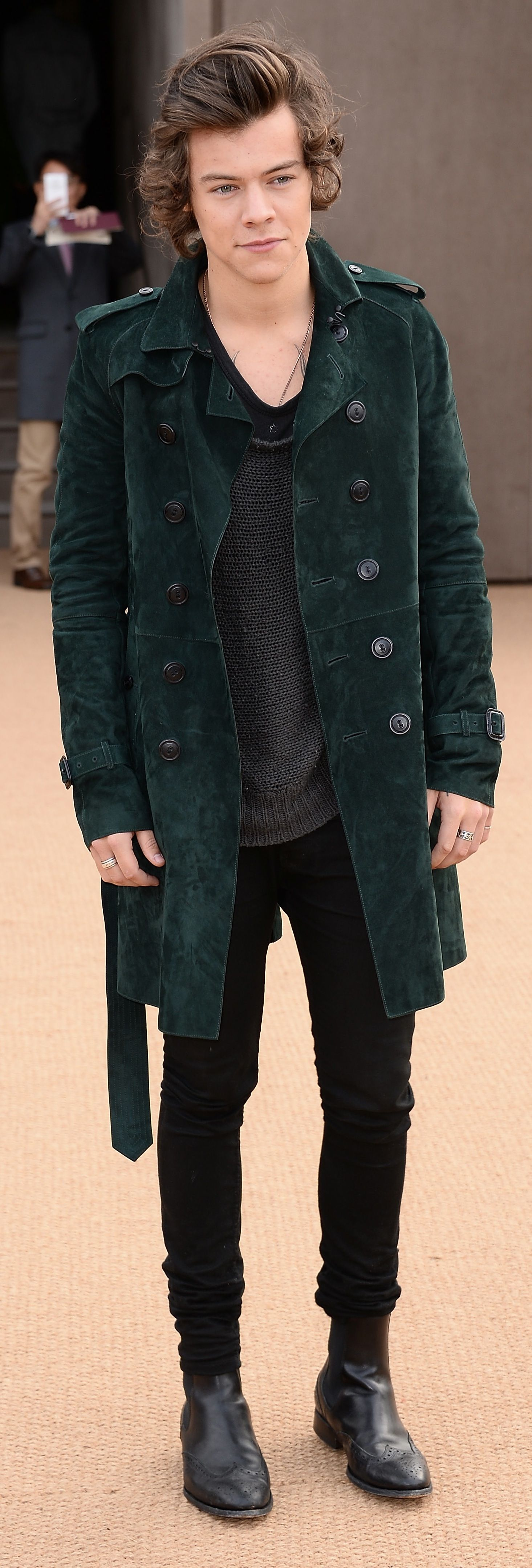 British musician Harry Styles wearing Burberry at the Burberry Prorsum Womenswear Autumn/Winter 2014 show in London