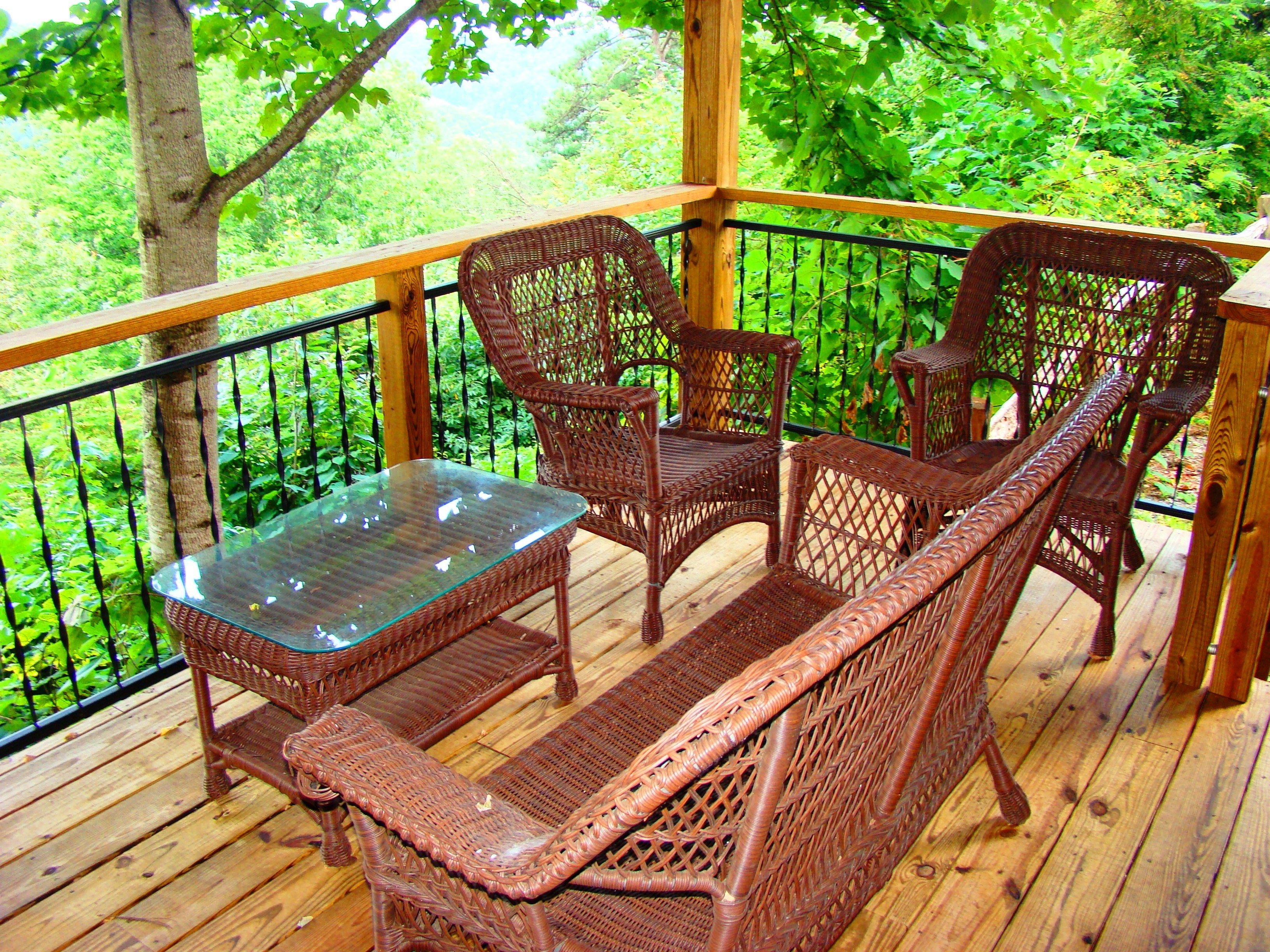 Relax On The Covered Porch At Bear Hug Cabin In Bryson City Nc Pet Friendly Cabins Cabin Rentals Outdoor Furniture Sets