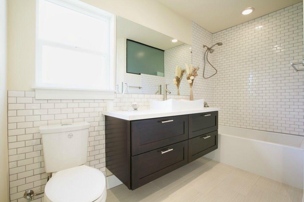 Espresso Cabinets And Pure White Quartz Floating Vanity