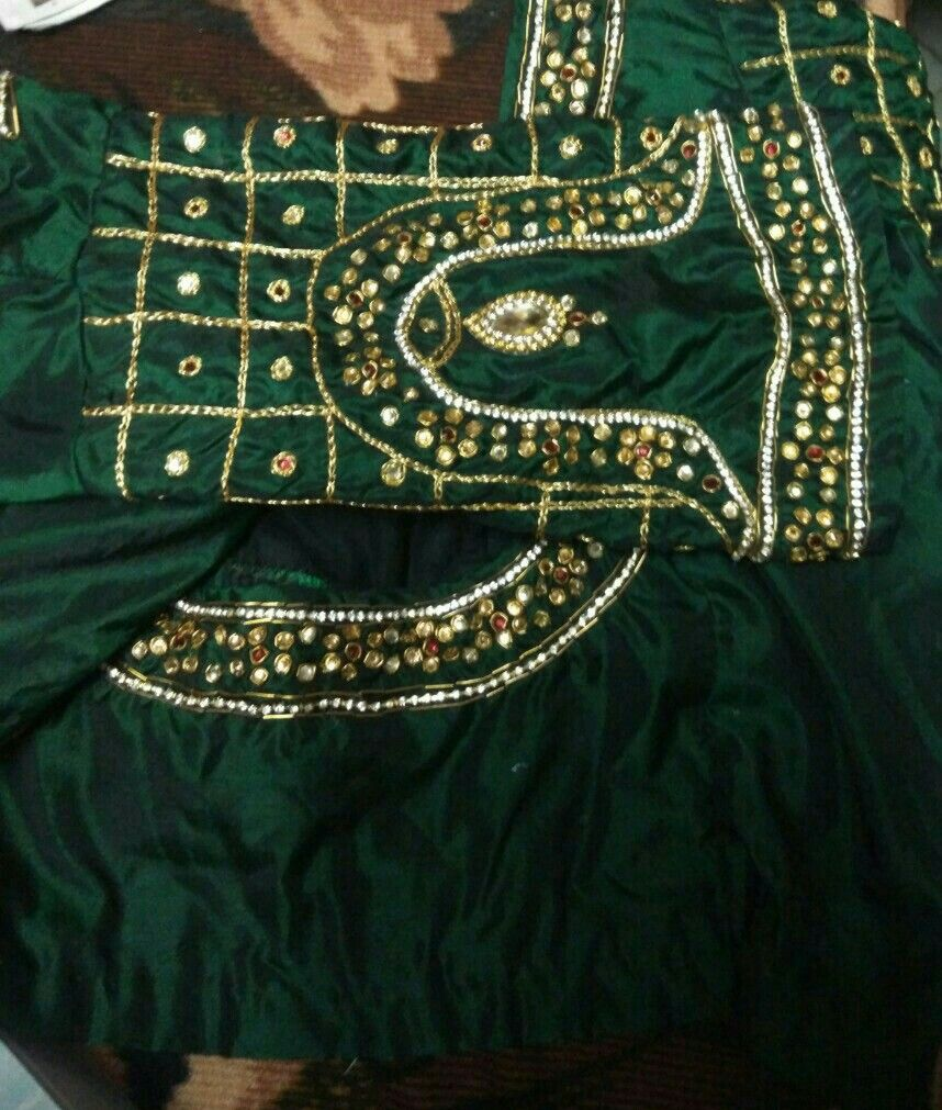 6fe5d012161be4 Dark green pattu blouse with golden vanki work