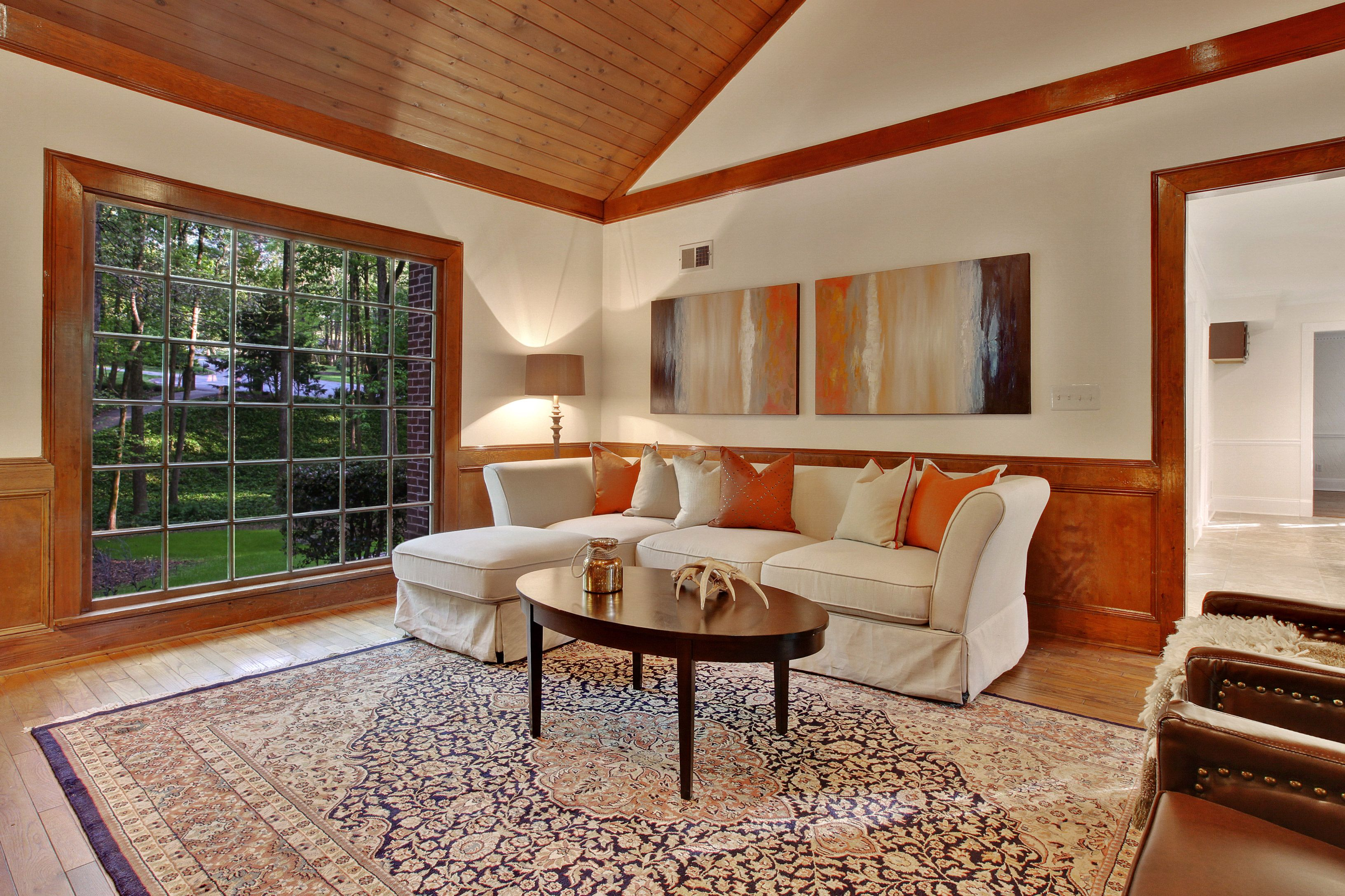 Great use of wall art to highlight the custom wood details in this great room with vaulted ceilings
