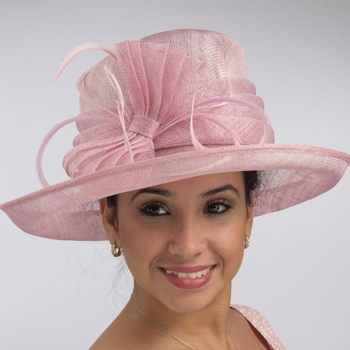 c42f61e5405 This medium sinamay hat is an elegant addition to your closet. The bow is…