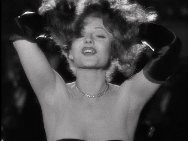 Style Essentials--Femme Fatale Rita Hayworth Puts the Blame in