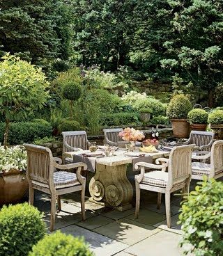 I like the feeling of this enveloped outdoor entertaining area with a wall of green surrounding it. I would add scented flowering plants, expalier fruit trees, herbs and veges.