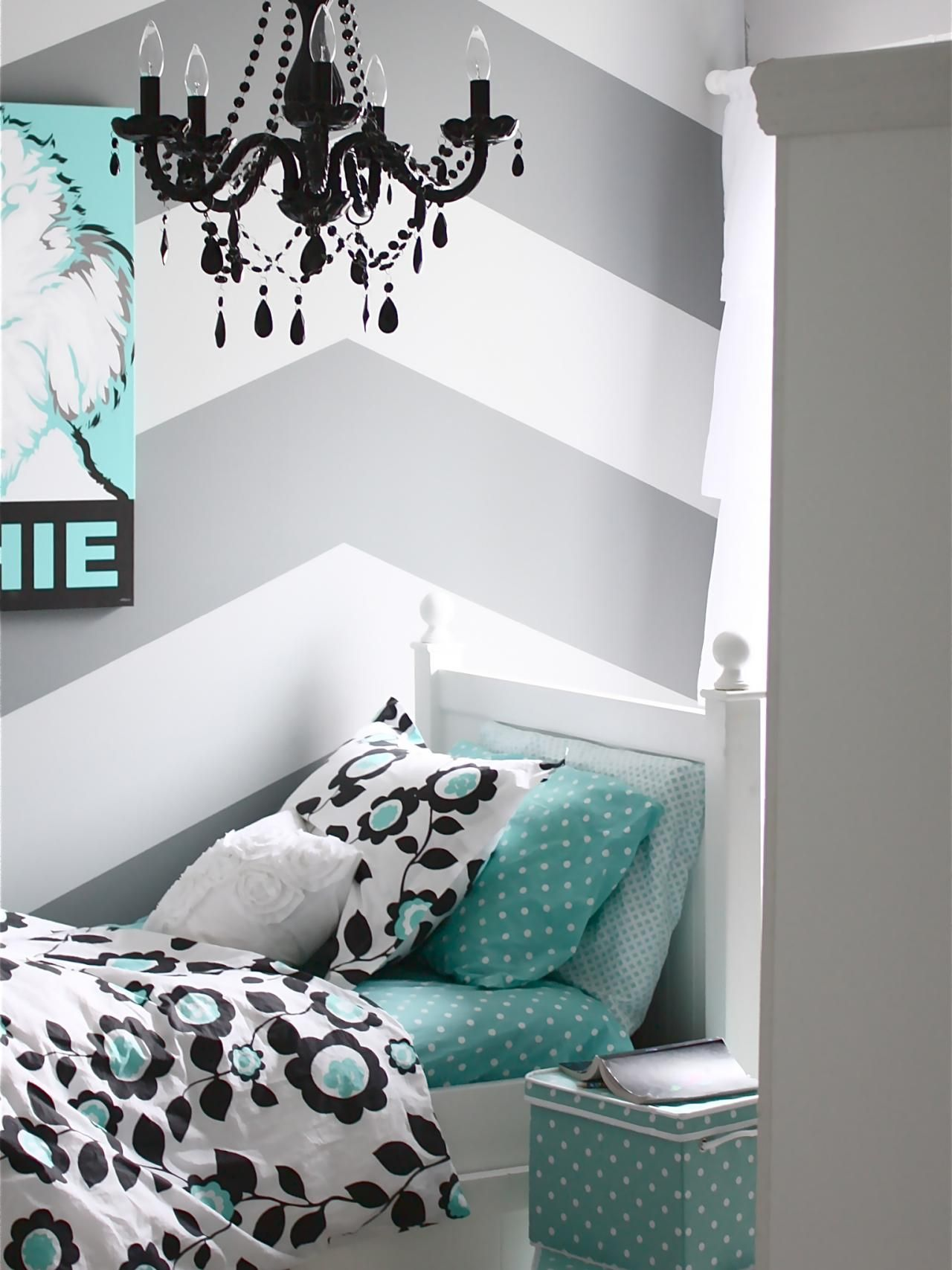 Using a black glass chandelier instead of a more traditional style adds funkiness to this hip tween's room. Silver, aqua and white accents balance out the heaviness of the black. Design by Sarah Macklem