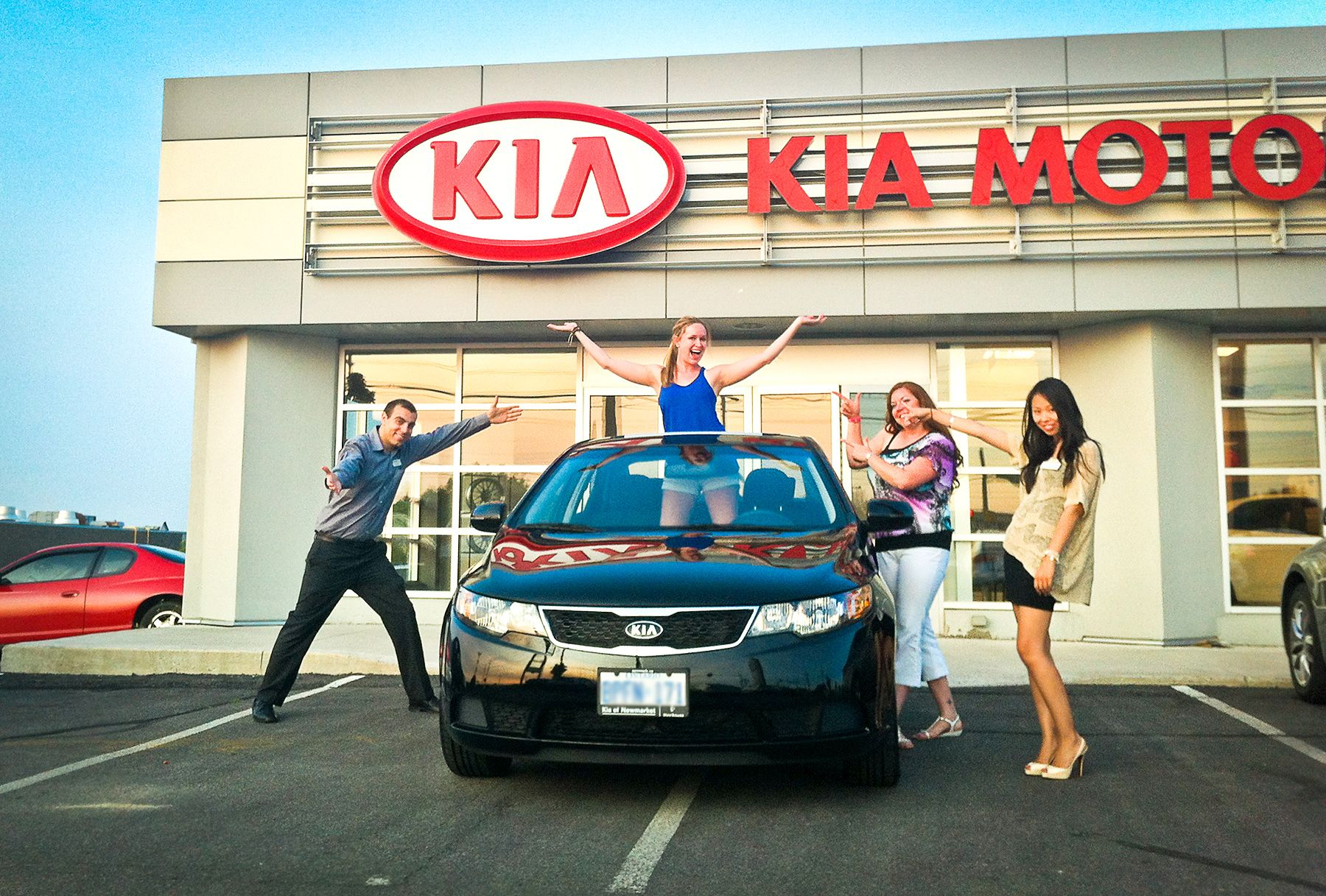 Picking up her new 2013 Kia Forte in Newmarket tario