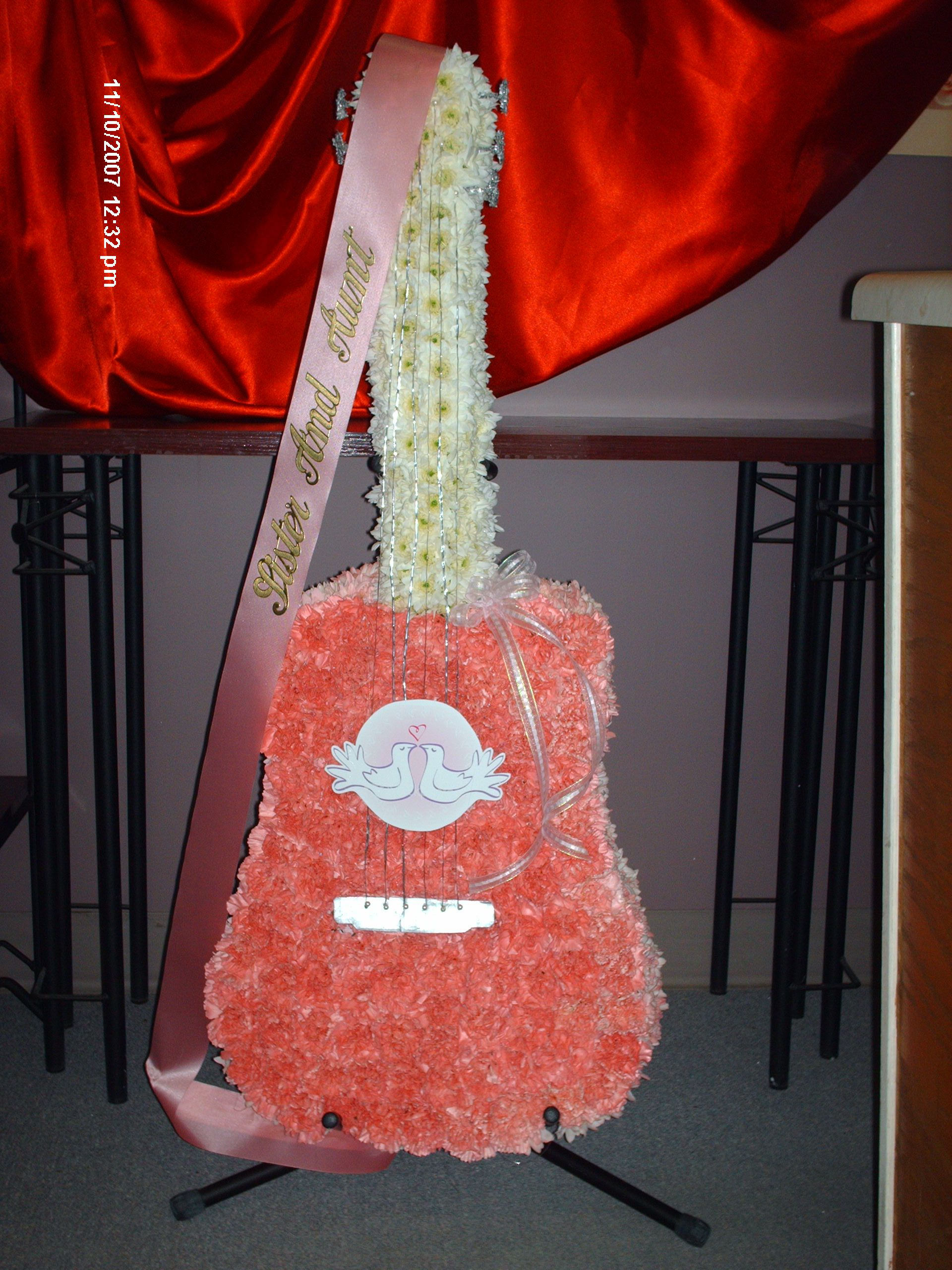 Custom designed for a loved one who played the guitar made funeral flowers custom designed for a loved one who played the guitar made completely of flowers using dhlflorist Image collections