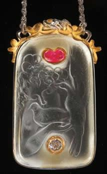 "Lalique 1920 'Colombes' Pendant: 1.75"" long, dove & angel motif: glass pendant later mounted by J.Fisk in a platinum & white & yellow gold mount w/ruby & diamond additions"