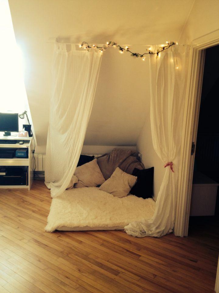 Used some ikea curtains, a rail, fairy lights, a bean bag, some ...