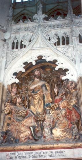 """Johannes de Doper..  1531. Steensculptuur kooromgang. Frankrijk, Armiens, kathedraal Notre Dame. Johannes ziet Jezus voorbijgaan en zegt: """"Zie het Lam Gods"""" (Johannes 1, 36)."""