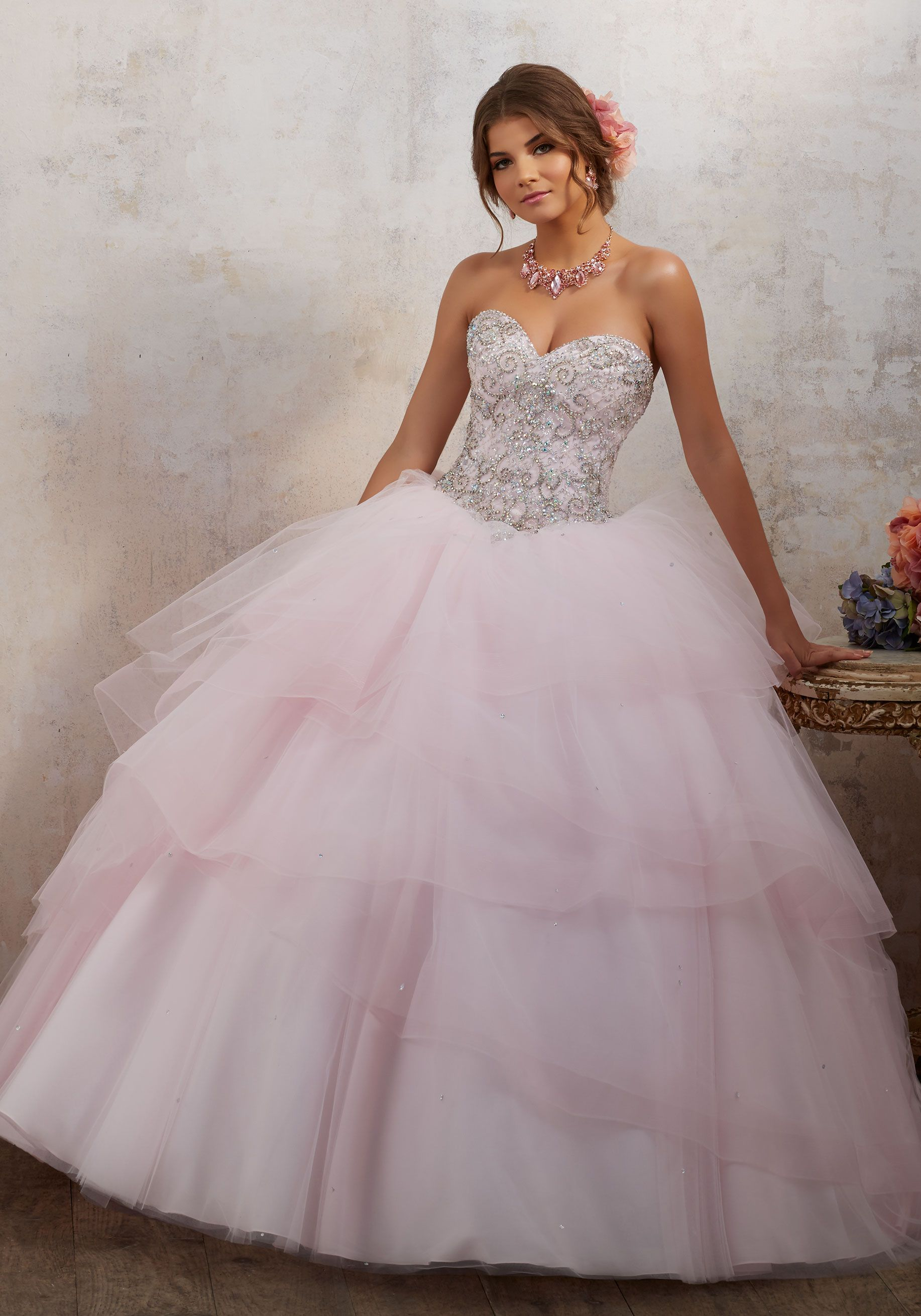 bee72de5b6 Dreamy Tulle Quinceañera Ballgown Features Gemstone Beaded Bodice with  Corset Back. Tiered Skirt is Accented with Scattered Beading. Matching  Bolero Jacket