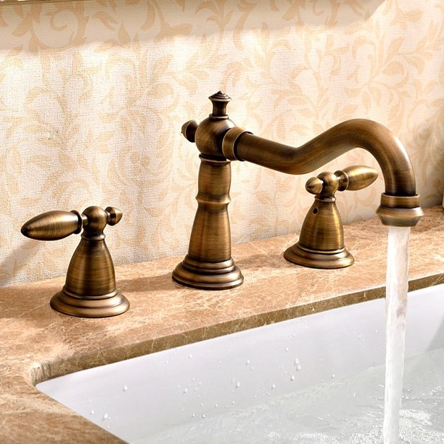 Photo of Herita Classic Widespread double handle brass sink faucet in antique brass