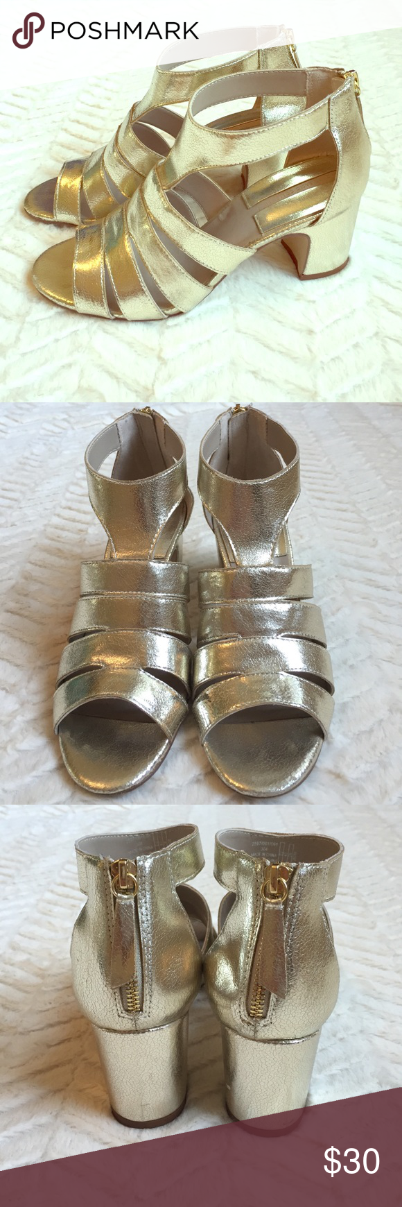 Zara Metallic Sandals Beautiful and comfortable gold heels! I wore these once to an outdoor event. Color is a soft gold...not a super yellow gold. Back zip. Only signs of wear are on the bottoms of the shoes and there is also a scuff on the inside of the right heel (see photo). Otherwise in great condition! Zara Shoes Sandals