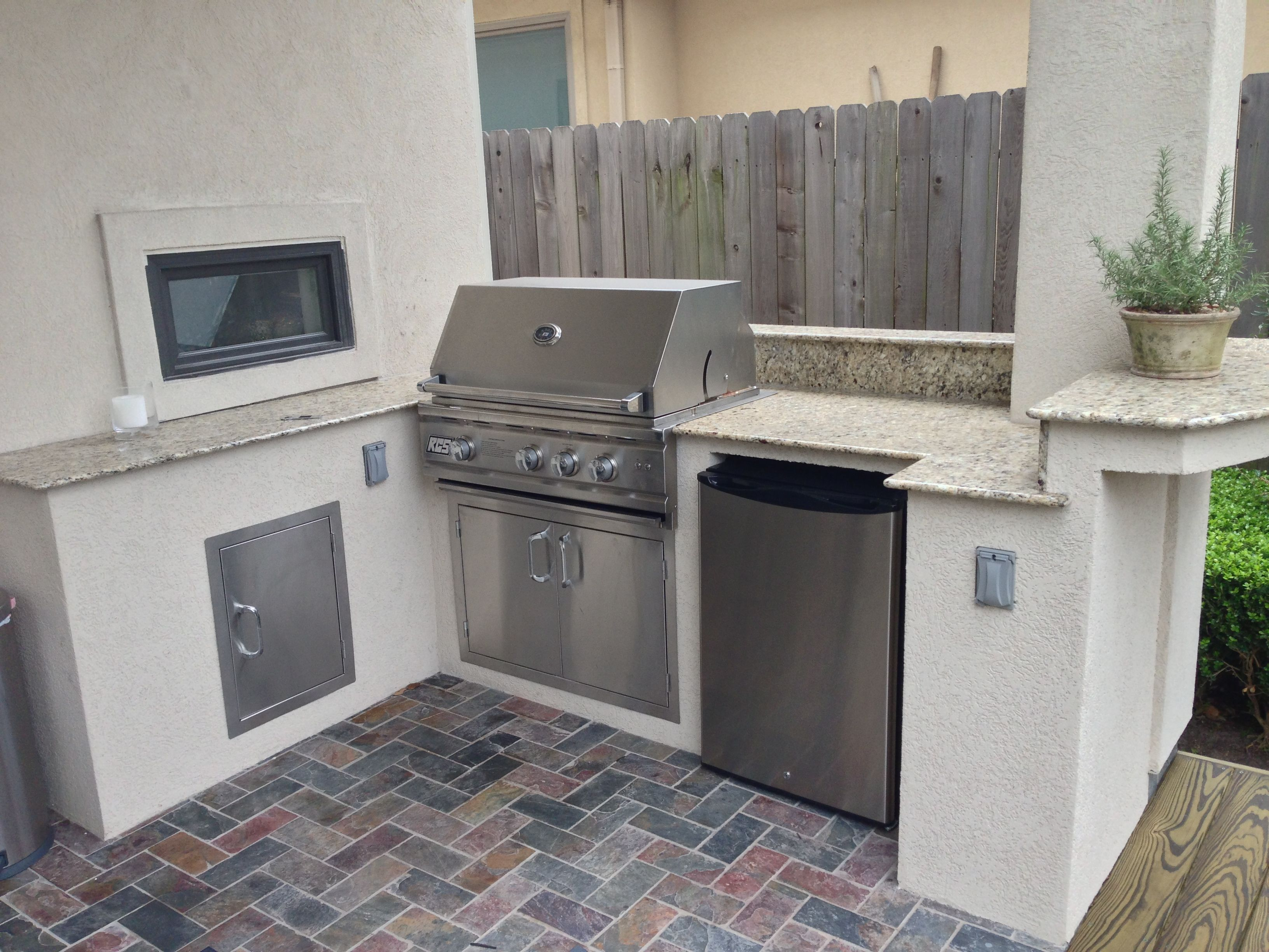 Custom Stucco Outdoor Kitchen With A Small Raised Counter For Bar Seating We Matched The