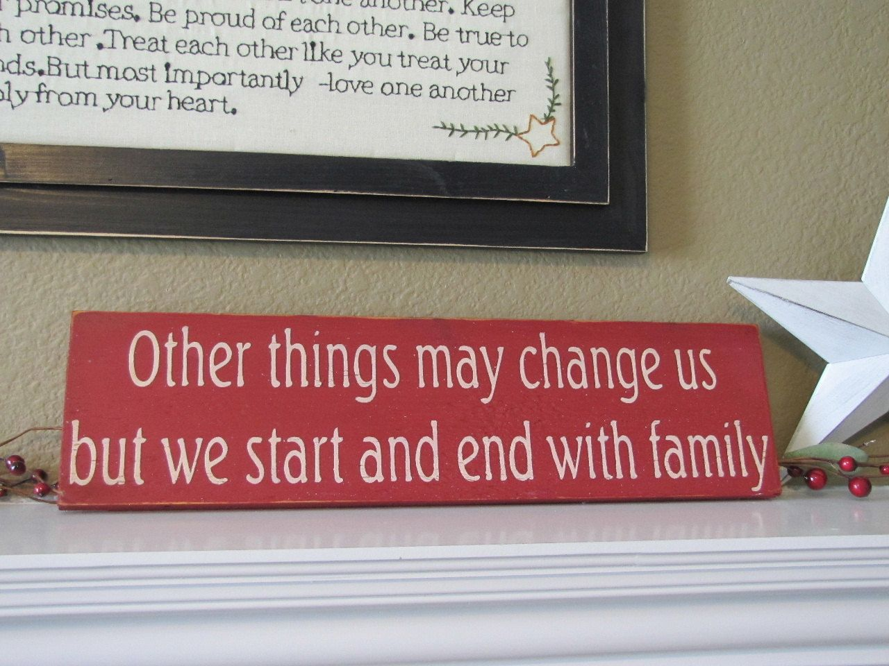 We Start and End With Family Wood Primitive Sign Wall Hanging. $12.00, via Etsy.