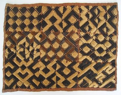 Kuba cloth uses bold geometries and rich textures of hand-woven raffia from the…